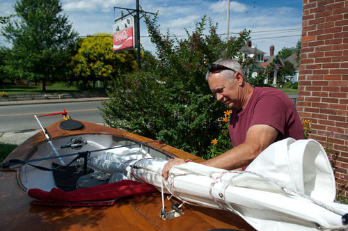 John Guider secures the sail rigging to his boat as he prepares to drive to drive to the coast for the second leg of his Great Loop journey. photo by Stacey Irvin